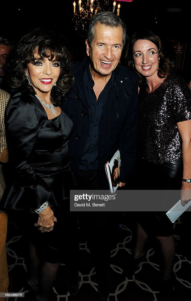 Joan Collins, Mario Testino and guest attend the launch of Joan Collins new book 'Passion For Life' at No.41 Mayfair Club at The Westbury Hotel on October 21, 2013 in London, England.
