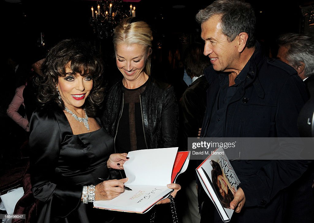 Joan Collins, Tamara Beckwith and Mario Testino attend the launch of Joan Collins new book 'Passion For Life' at No.41 Mayfair Club at The Westbury Hotel on October 21, 2013 in London, England.