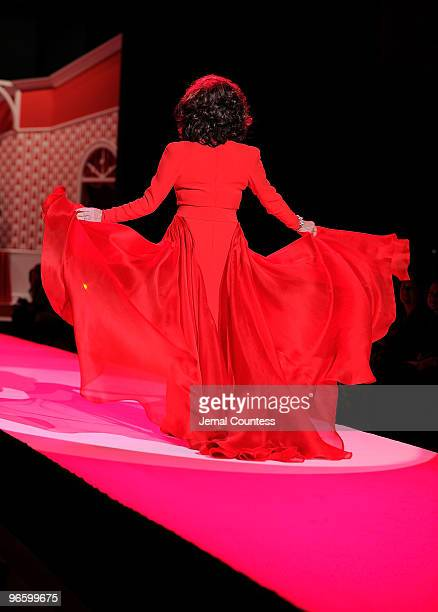 Joan Collins walks the runway at the Heart Truth Fall 2010 Fashion Show during MercedesBenz Fashion Week at The Tent at Bryant Park on February 11...