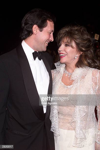 Joan Collins with husband Percy Gibson arriving at the Vanity Fair Oscar Party 2002 at Morton's in Los Angeles CA March 24 2002 Photo Evan...
