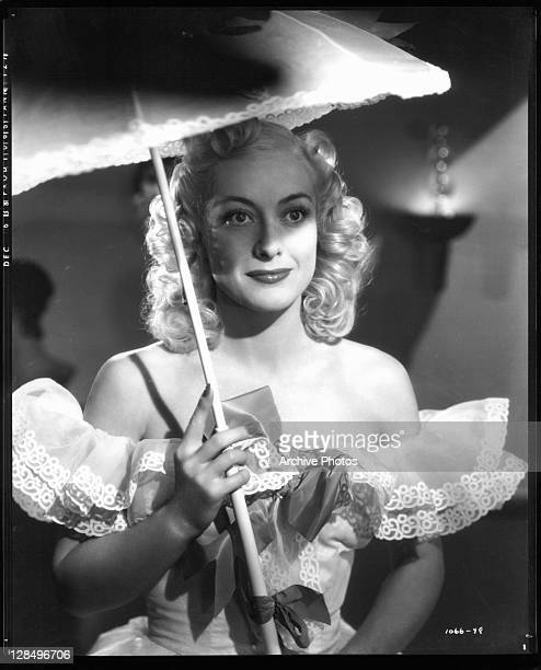 Joan Crawford holding umbrella in a scene from the film 'The Ice Follies Of 1939' 1939