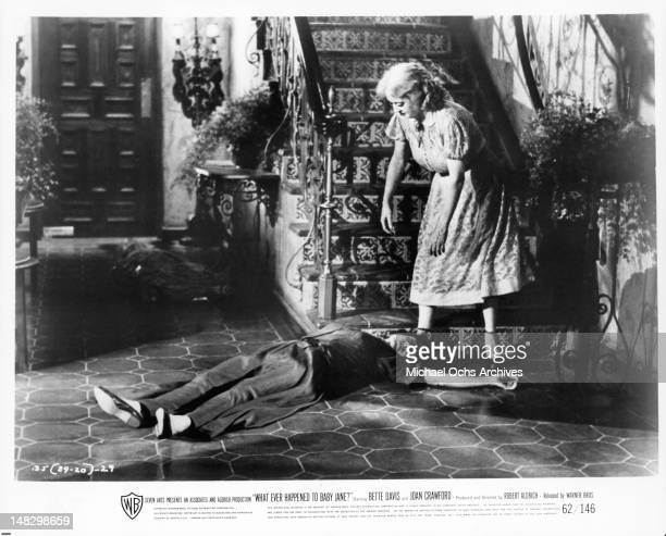Joan Crawford on the floor in front of Bette Davis in a scene from the film 'What Ever Happened To Baby Jane' 1962
