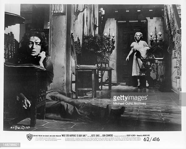 Joan Crawford on the phone in fear as Bette Davis enters the house in a scene from the film 'What Ever Happened To Baby Jane' 1962