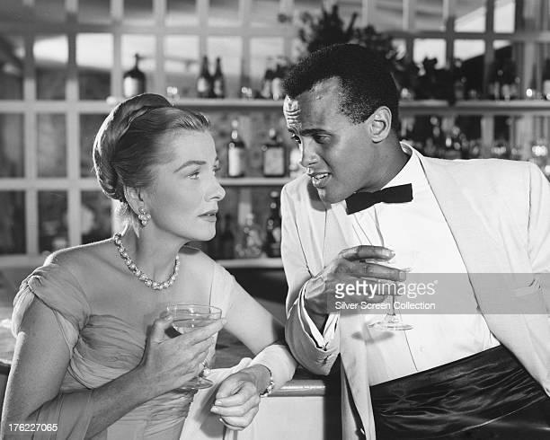 Joan Fontaine as Mavis Norman and Harry Belafonte as David Boyeur in 'Island In the Sun' directed by Robert Rossen 1957