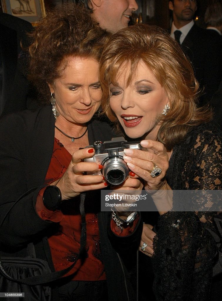 Joan Jeddell shows Joan Collins her picture during Official 2003 Academy of Motion Picture Arts and Sciences Oscar Night Party at Le Cirque 2000 at Le Cirque 2000 in New York, NY, United States.