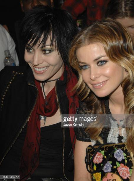 Joan Jett and Carmen Electra during Mercedes Benz Fashion Week Fall 2007 Anna Sui Front Row and Backstage at The Tent Bryant Park in New York City...