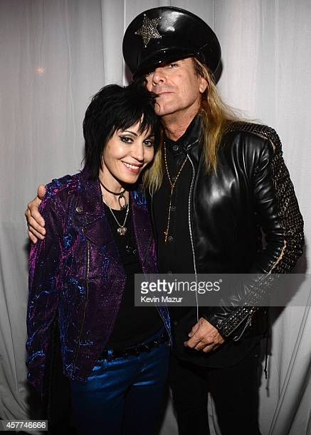 Joan Jett and Robin Zander of Cheap Trick backstage during The 6th Annual Little Kids Rock Benefit at Hammerstein Ballroom on October 23 2014 in New...