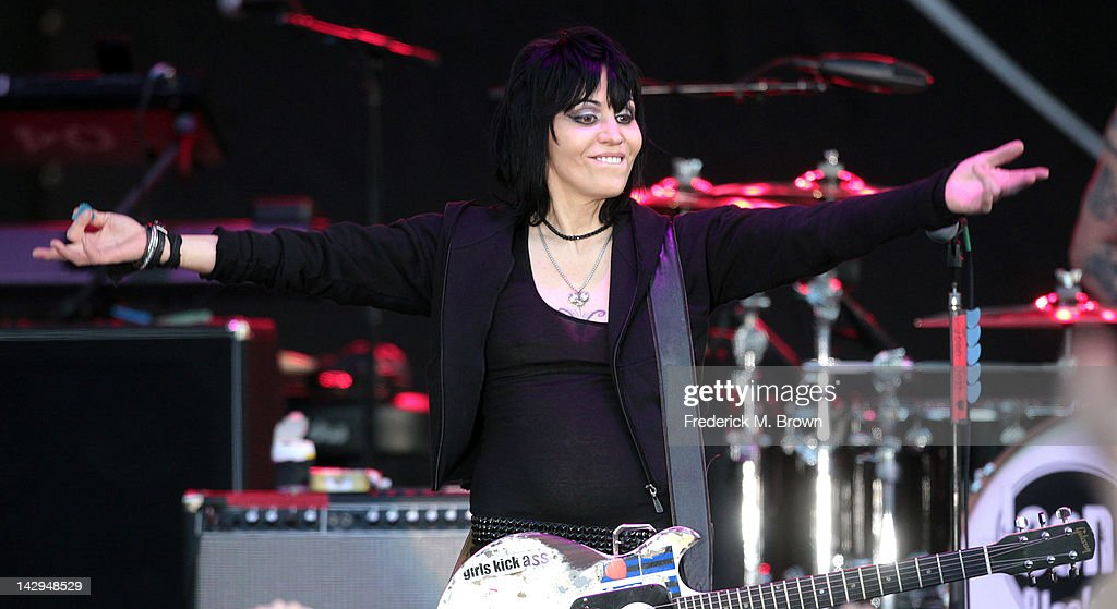 <a gi-track='captionPersonalityLinkClicked' href=/galleries/search?phrase=Joan+Jett&family=editorial&specificpeople=213317 ng-click='$event.stopPropagation()'>Joan Jett</a> and the Blackhearts perform during the 36th Annual Toyota Pro/Celebrity Race at the Long Beach Grand Prix on April 14, 2012 in Long Beach, California.