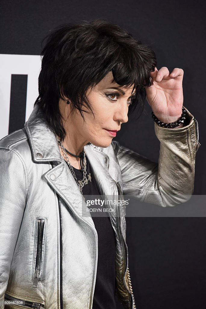 Joan Jett attends the Yves Saint Laurent men's fall line and the first part of its women's collection fashion show at the Paladium, in Hollywood, California, February 10, 2016. / AFP / ROBYN BECK