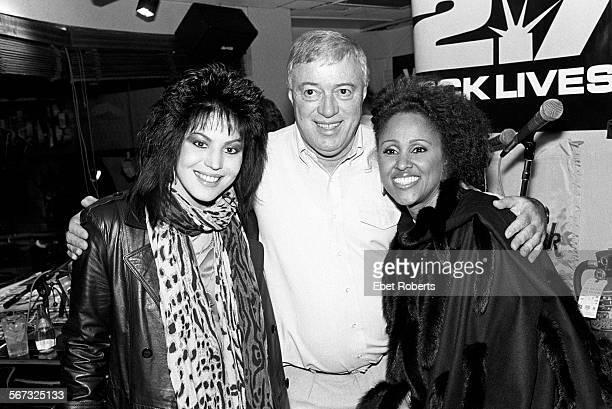 Joan Jett with WNEW Radio DJ Scott Muni and singer Darlene Love at the Hard Rock Cafe in New York City on October 29 1987