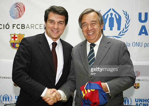 Joan Laporta President of Barcelona football club shakes hands with United Nations High Commissioner Antonio Guterres after signing an agreement to...
