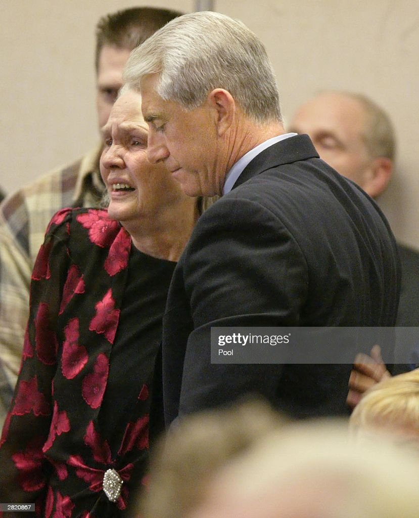 Joan Mackie mother of Green River Killer victim Cindy Smith gets a hug from King County Sheriff Dave Reichert at the sentencing of Gary Ridgway in King County Washington Superior Court December 18, 2003 in Seattle, Washington. Ridgway received 48 life sentences, with out the possibility of parole, for killing 48 women over the past 20 years in the Green River Killer serial murder case.