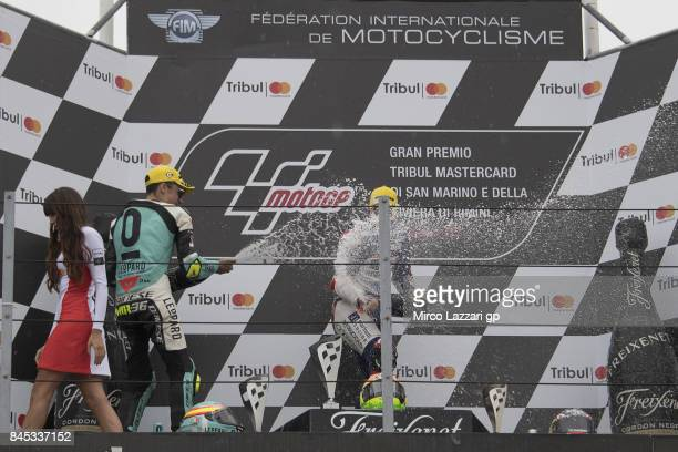 Joan Mir of Spain and Leopard Racing and Romano Fenati of Italy and Marinelli Rivacold Snipers Team celebrate on the podium at the end of the Moto3...
