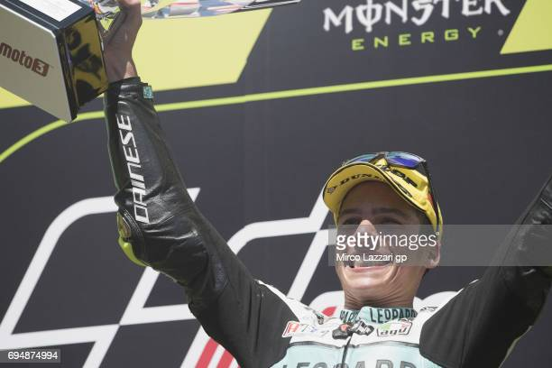 Joan Mir of Spain and Leopard Racing celebrates the victory on the podium at the end of the Moto3 race during the MotoGp of Catalunya Race at Circuit...