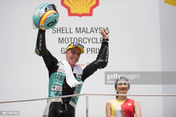 Joan Mir of Spain and Leopard Racing celebrates the victory on the podium at the end of the Moto3 race during the MotoGP Of Malaysia Race at Sepang...