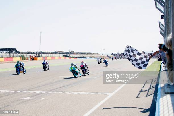 Joan Mir of Spain and Leopard Racing cuts the finish lane and celebrates the victory at the end of the Moto3 race during the MotoGP of Aragon Race at...