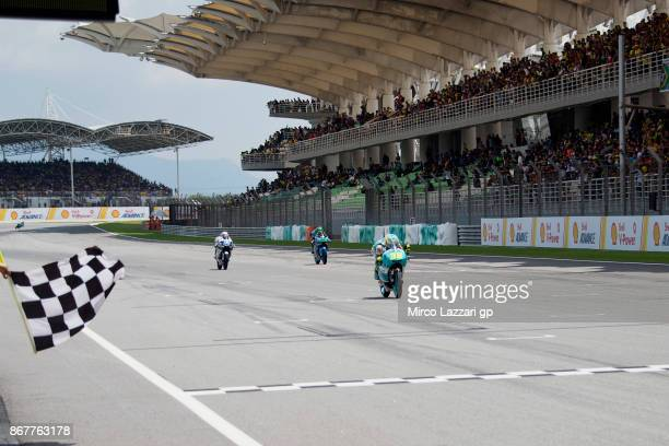 Joan Mir of Spain and Leopard Racing cuts the finish lane and celebrates the victory at the end of the Moto3 race during the MotoGP Of Malaysia Race...