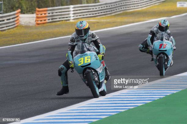 Joan Mir of Spain and Leopard Racing leads Livio Loi of Belgium and Leopard Racing during the MotoGp of Spain Free Practice at Circuito de Jerez on...