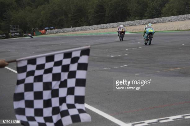 Joan Mir of Spain and Leopard Racing leads Romano Fenati of Italy and Marinelli Rivacold Snipers Team and cuts the finish lane and wins during the...