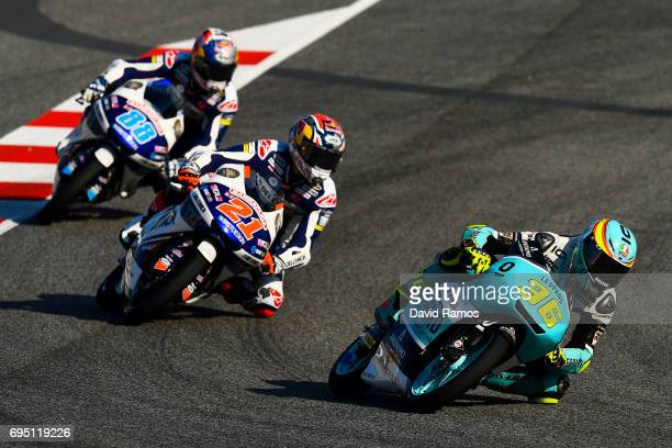 Joan Mir of Spain and Leopard Racing rides ahead Fabio di Giannantonio of Italy and Del Conca Gresini Moto3 and Jorge Martin of Spain and Del Conca...
