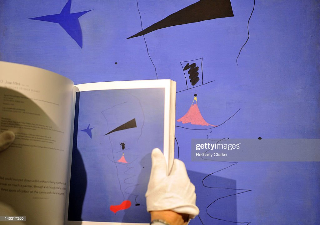 Joan Miro's 'Peinture (Etoile Blueu)' is placed on a wall at Sotheby's on June 14, 2012 in London, England. This is among the most important works by the artist that has ever come to auction and is expected to fetch an estimated £15-20 million. This piece is part of the Impressionist & Modern and Contemporary Art sale at Sotheby's which will be held on June 19, 2012 and June 20, 2012.
