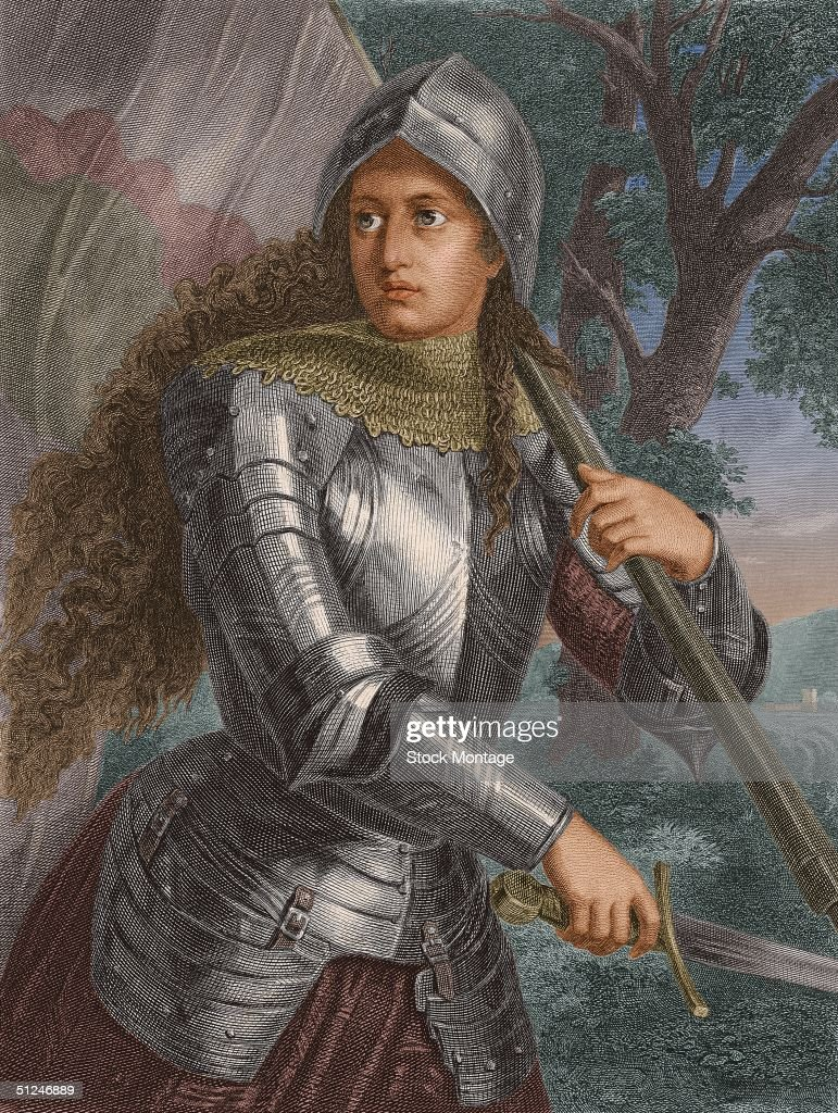 1429, Joan of Arc (c. 1412 - 1431), French saint and national heroine who led her troops to victory over the British during the Hundred Years War, carrying a sword and a flag on the battlefield.