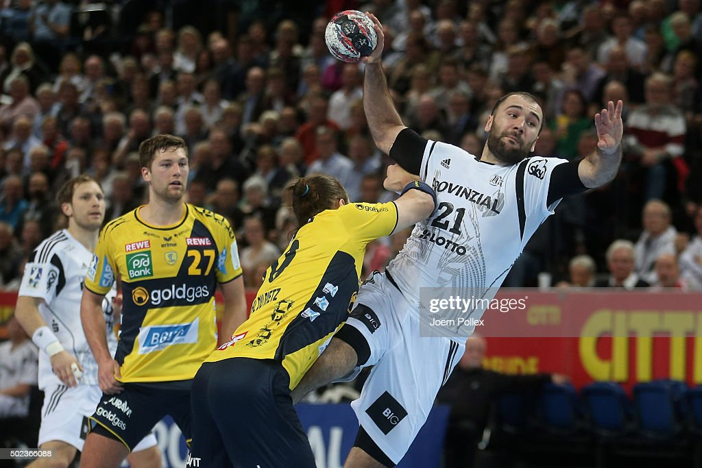 Joan Reixach Canellas (R) of Kiel scores during the DKB HBL Bundesliga match between THW Kiel and Rhein-Neckar Loewen at Sparkassen Arena on December 23, 2015 in Kiel, Germany.