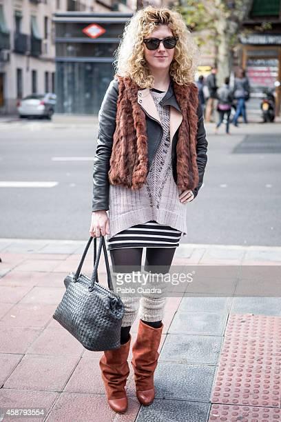 Joan Rose wears Chioc boots Vintage skirt Ragen Bone pullover Vintage Belstaff vest Bottega Venea handbag and RayBan sunglasses during the 'Mercado...