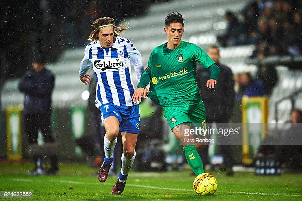 Joan Simun Edmundsson of OB Odense and Svenn Crone of Brondby IF compete for the ball during the Danish Alka Superliga match between OB Odense and...