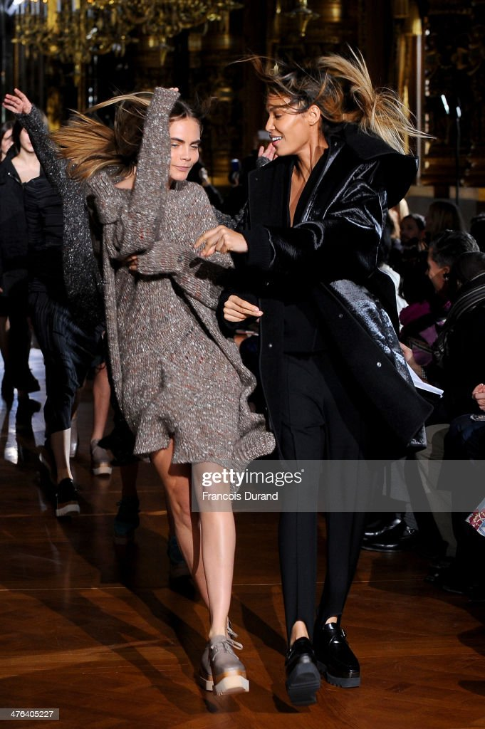 Joan Smalles and Cara Delevigne walk the runway during the Stella McCartney show as part of the Paris Fashion Week Womenswear Fall/Winter 2014-2015 on March 3, 2014 in Paris, France.