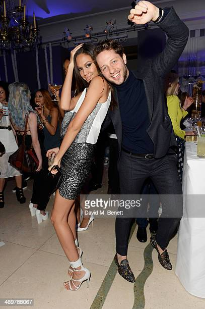 Joan Smalls and Derek Blasberg attend the Mulberry dinner to celebrate the launch of the Cara Delevingne Collection at Claridge's Hotel on February...