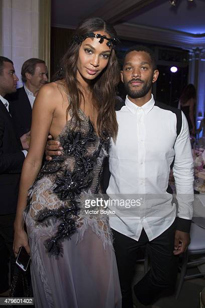 Joan Smalls and her guest attend the amfAR dinner at the Pavillon LeDoyen during the Paris Fashion Week Haute Couture on July 5 2015 in Paris France