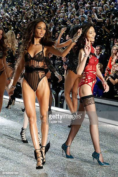 Joan Smalls and Liu Wen walk the runway during the finale of the 2016 Victoria's Secret Fashion Show at Le Grand Palais on November 30 2016 in Paris...