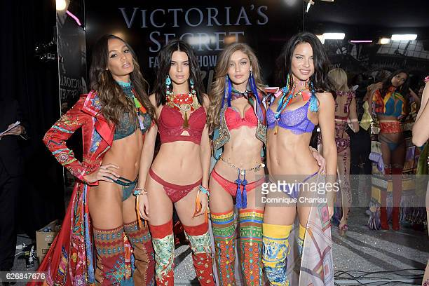 Joan Smalls Kendall Jenner Gigi Hadid and Adriana Lima poses backstage during the Victoria's Secret Fashion Show on November 30 2016 in Paris France