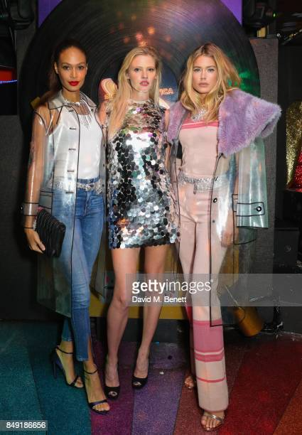 Joan Smalls Lara Stone and Doutzen Kroes attend the Miu Miu LOVE party at Loulou's on September 18 2017 in London England