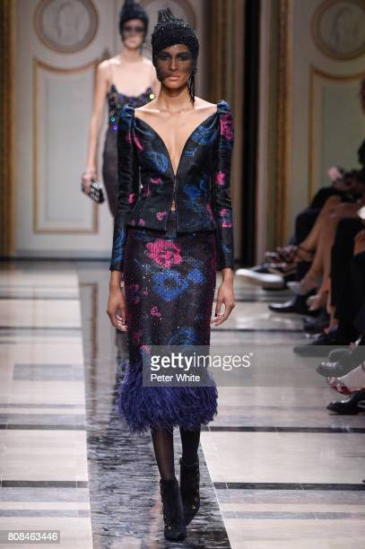 Joan Smalls walks the runway during the Giorgio Armani Prive Haute Couture Fall/Winter 20172018 show as part of Haute Couture Paris Fashion Week on...