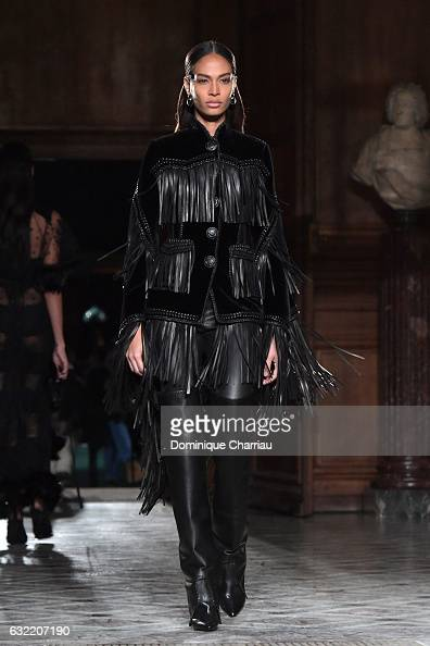 Joan Smalls walks the runway during the Givenchy Menswear Fall/Winter 20172018 show as part of Paris Fashion Week on January 20 2017 in Paris France