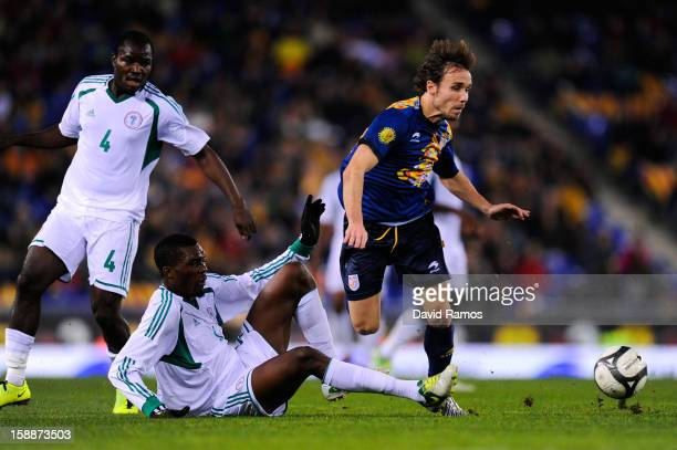 Joan Verdu of Catalonia duels for the ball with Egwuekwe Azubuike of Nigeria during a friendly match between Catalonia and Nigeria at CornellaEl Prat...