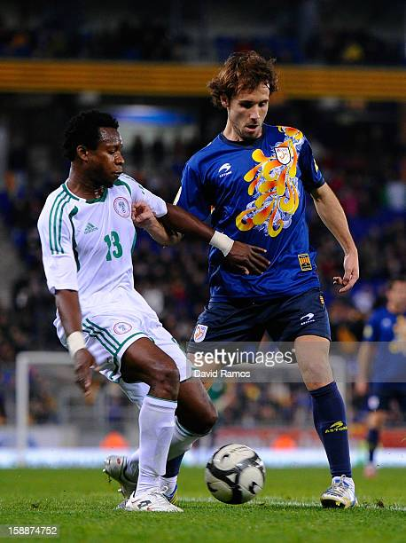 Joan Verdu of Catalonia duels for the ball with Emenike Emmanuel of Nigeria during a friendly match between Catalonia and Nigeria at CornellaEl Prat...