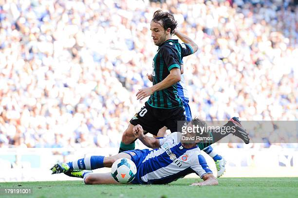 Joan Verdu of Real Betis Balompie duels for the ball with Victor Sanchez of RCD Espanyol during the La Liga match between RCD Espanyol and Real Betis...