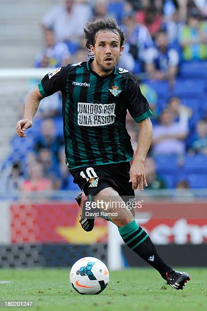 Joan Verdu of Real Betis Balompie runs with the ball during the La Liga match between RCD Espanyol and Real Betis Balompie at CornellaEl Prat Stadium...
