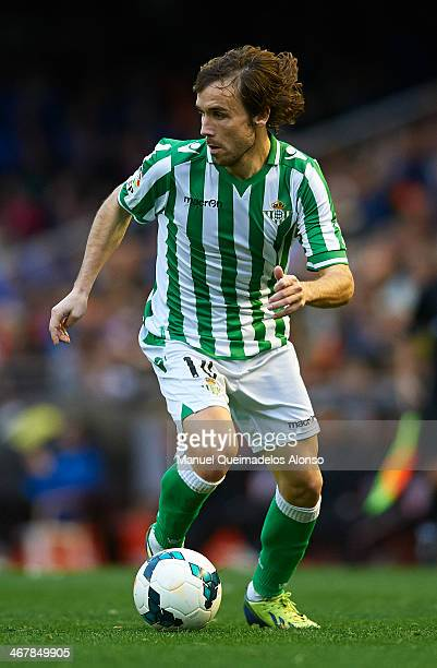 Joan Verdu of Real Betis runs with the ball during the La Liga match between Valencia CF and Real Betis Balompie at Estadio Mestalla on February 08...