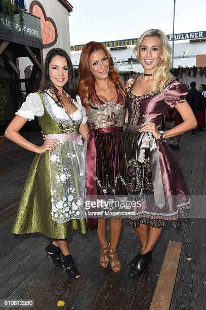 Joana Danciu Yasmina Filali and Verena Kerth attend the BILD Wiesn at Marstall Festzelt during the Oktoberfest at Theresienwiese on September 26 2016...