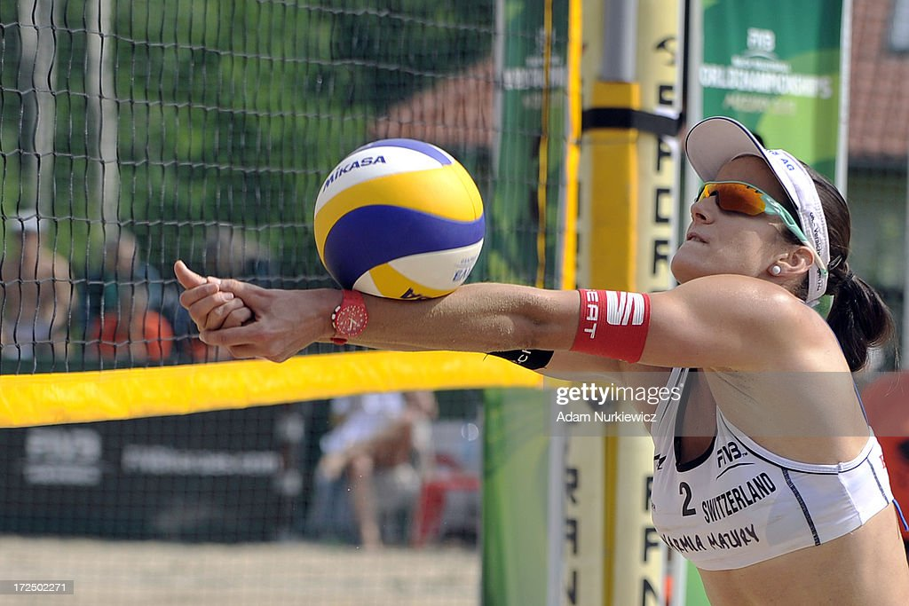 Joana Heidrich of Switzerland passes the ball during Day 2 of the FIVB World Championships on July 2, 2013 in Stare Jablonki, Poland.