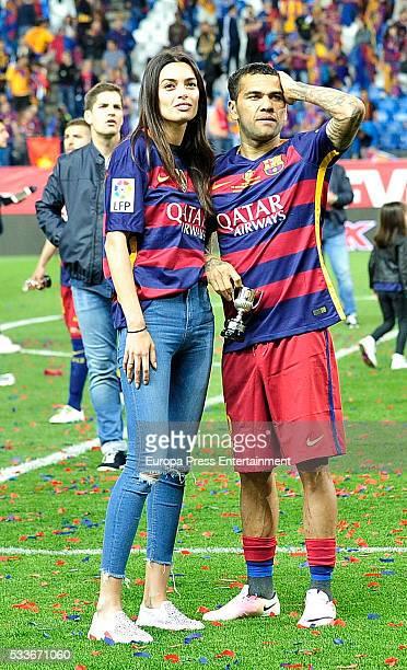 Joana Sanz and Dani Alves attend the Copa del Rey match FC Barcelona vs Sevilla FC at Vicente Calderon Stadium on May 22 2016 in Madrid Spain