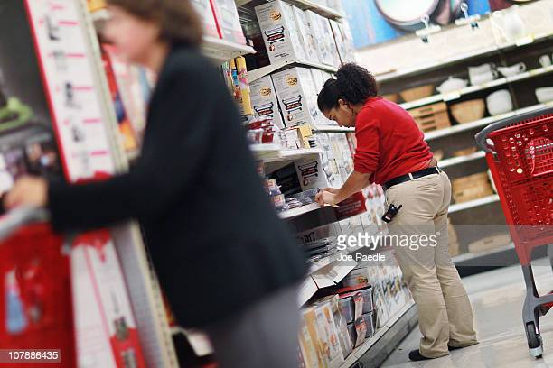 Joanely Carrero restocks shelves at a Target store where a week ago she became a full time employee after being hired initially as a seasonal worker...