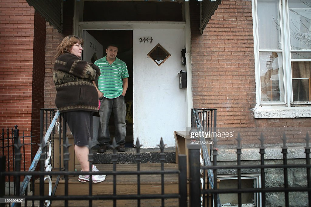 JoAnn Teneg and her husband Esteban Dorantes stand in front of their home on January 12, 2013 in Chicago, Illinois. Esteban's 14-year-old son Rey Dorantes was shot and killed while sitting on the porch and chatting on the phone the night before. Dorantes, who was one of 6 teenagers shot in Chicago on January 11, became the 21st homicide in the city for 2013. In 2012 Chicago had more than 500 homicides.