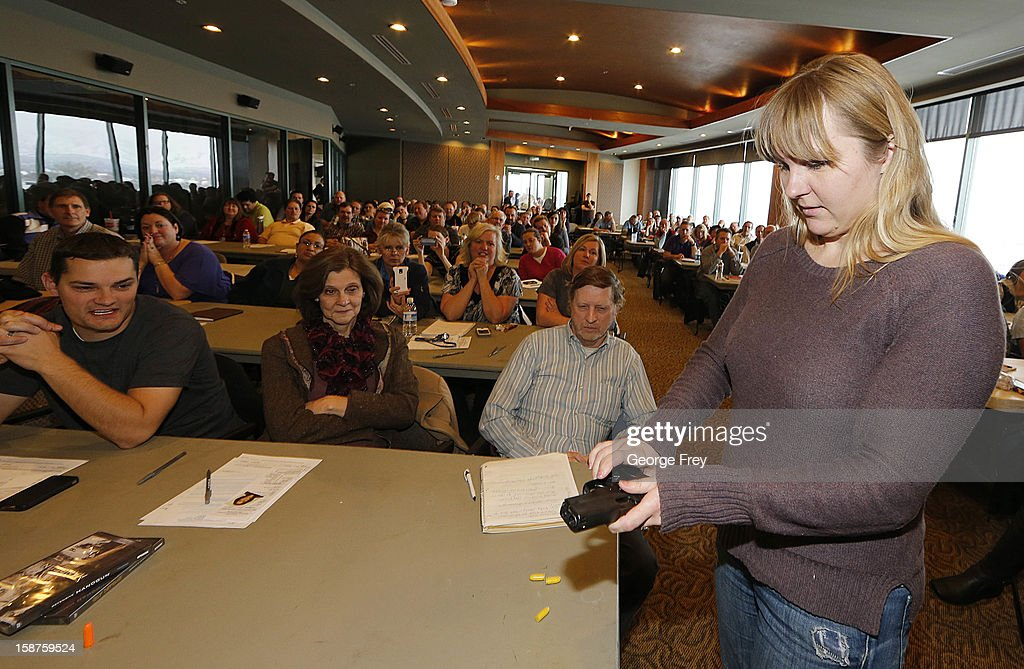 Joanna Baginska, (R) a fourth grade teacher at Odyssey Charter School in American Fork, Utah learns how to load a 40 cal. Sig Sauer at a concealed-weapons training class to 200 Utah teachers on December 27, 2012 in West Valley City, Utah. The Utah Shooting Sports Council said it would waive its $50 fee for concealed-weapons training for Utah teachers.