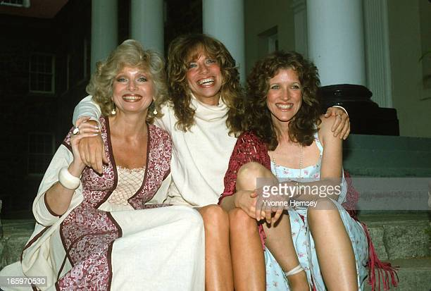 Joanna Carly and Lucy Simon pose for a photograph before their concert May 12 1982 in New York City The Simon sisters returned to their school for a...