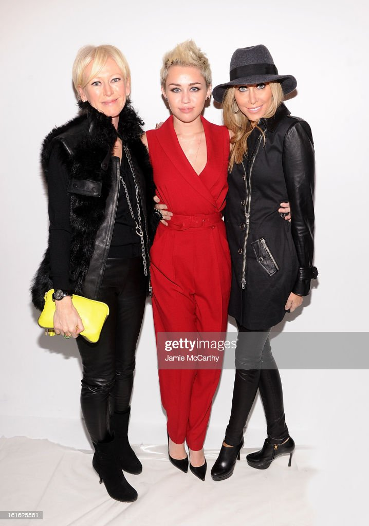 Joanna Coles editorinchief of Marie Claire magazine Miley Cyrus and Tish Cyrus attend Rachel Zoe during Fall 2013 MercedesBenz Fashion Week at The...